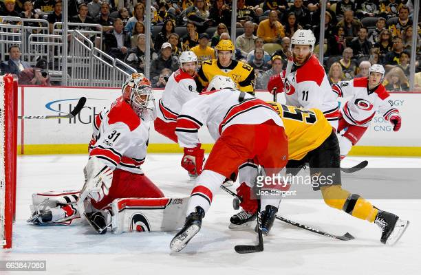 Eddie Lack of the Carolina Hurricanes protects the net against the Pittsburgh Penguins at PPG Paints Arena on April 2 2017 in Pittsburgh Pennsylvania