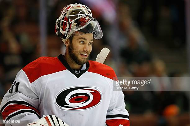 Eddie Lack of the Carolina Hurricanes smiles during the third period of a game against the Anaheim Ducks at Honda Center on December 11 2015 in...