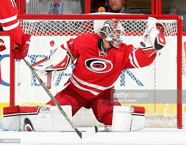 Eddie Lack of the Carolina Hurricanes snatches the puck out of the air to make a glove save during a NHL game against the Dallas Stars at PNC Arena...