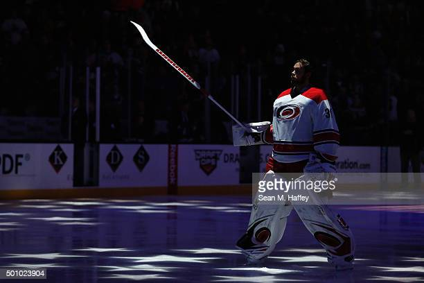 Eddie Lack of the Carolina Hurricanes stands during the national anthem prior to a game against the Anaheim Ducks at Honda Center on December 11 2015...