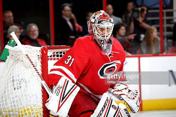 Eddie Lack of the Carolina Hurricanes turns to keep his eye on the puck to protect the net during an NHL game against the New Jersey Devils on...