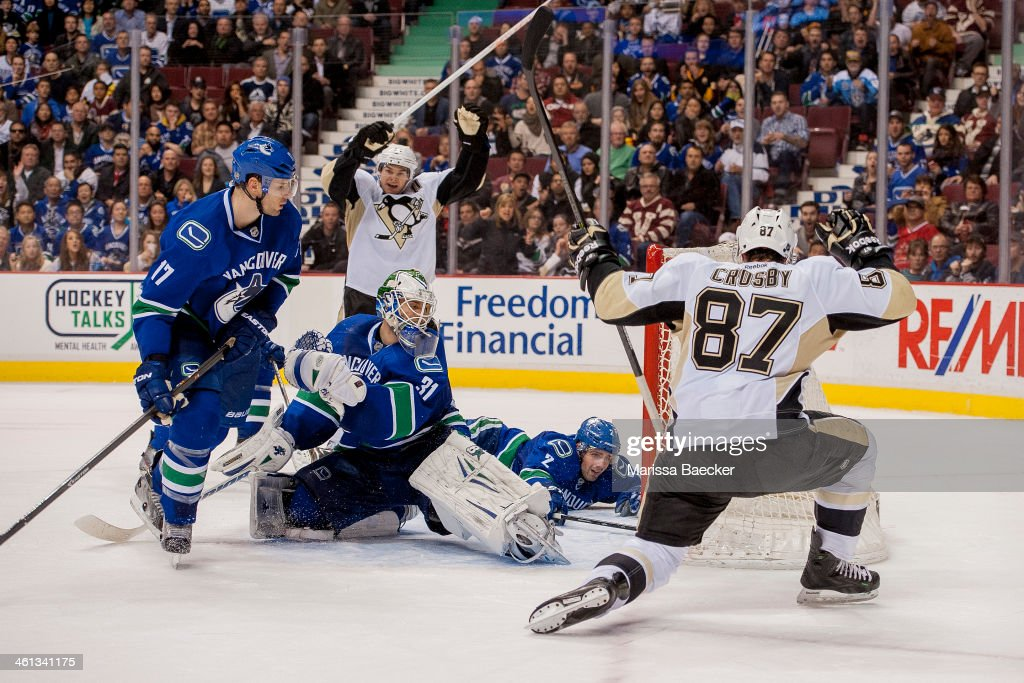 Eddie Lack #31 of the Vancouver Canucks allows a goal by <a gi-track='captionPersonalityLinkClicked' href=/galleries/search?phrase=Sidney+Crosby&family=editorial&specificpeople=212781 ng-click='$event.stopPropagation()'>Sidney Crosby</a> #87 of the Pittsburgh Penguins late in the third period on January 7, 2014 at Rogers Arena in Vancouver, British Columbia, Canada.
