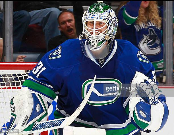 Eddie Lack of the Vancouver Canucks celebrates the shootoutwinning goal against the St Louis Blues in their NHL game at Rogers Arena March 1 2015 in...
