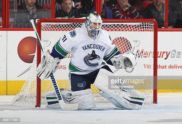 Eddie Lack of the Vancouver Canucks crouches in the crease to protect the net during their NHL game against the Carolina Hurricanes at PNC Arena on...