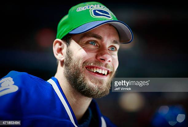 Eddie Lack of the Vancouver Canucks looks on from the bench during their NHL game against the Edmonton Oilers at Rogers Arena April 11 2015 in...