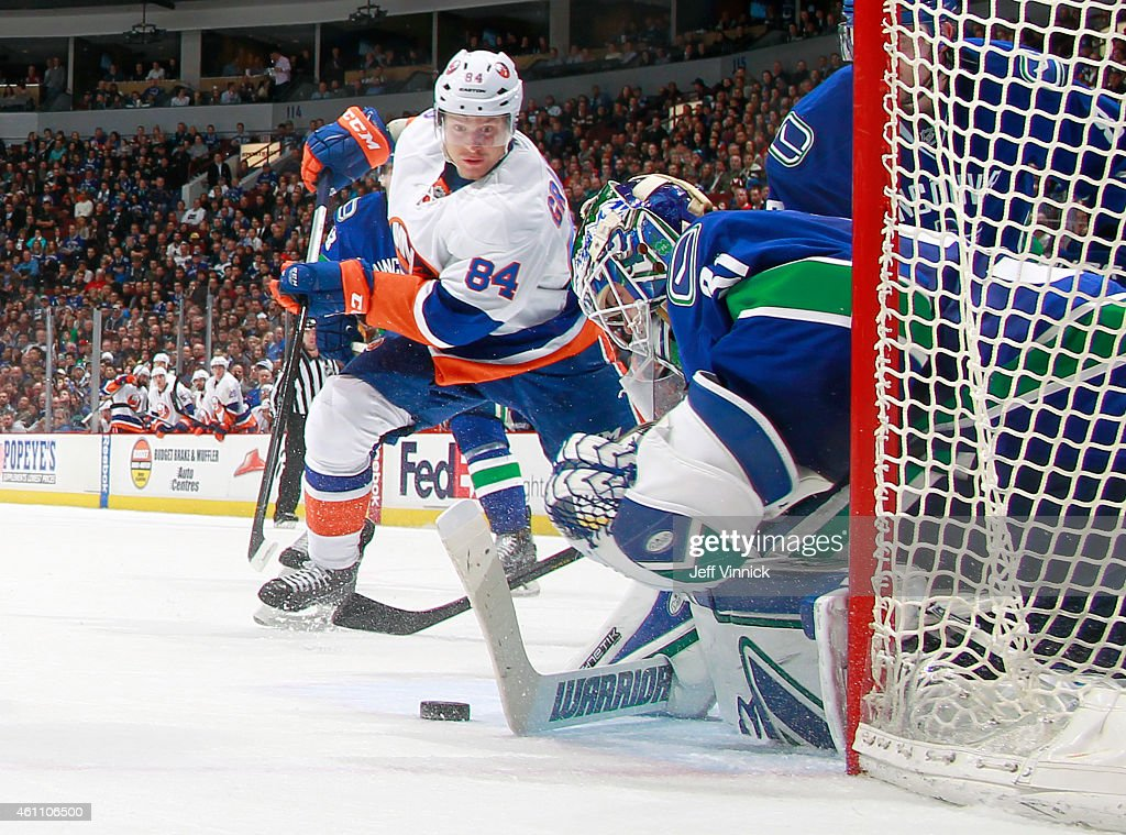 Eddie Lack #31 of the Vancouver Canucks makers a save on <a gi-track='captionPersonalityLinkClicked' href=/galleries/search?phrase=Mikhail+Grabovski&family=editorial&specificpeople=2560547 ng-click='$event.stopPropagation()'>Mikhail Grabovski</a> #84 of the New York Islanders during their NHL game at Rogers Arena January 6, 2015 in Vancouver, British Columbia, Canada. Vancouver won 3-2.