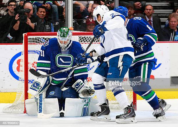 Eddie Lack of the Vancouver Canucks makes a save during their NHL game against the Tampa Bay Lightning at Rogers Arena October 18 2014 in Vancouver...