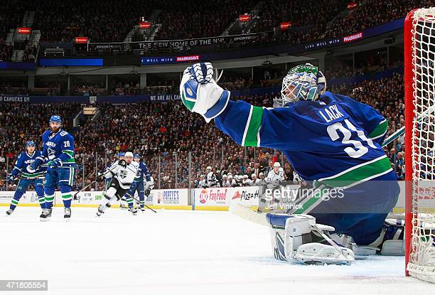Eddie Lack of the Vancouver Canucks makes a save during their NHL game against the Los Angeles Kings at Rogers Arena April 6 2015 in Vancouver...