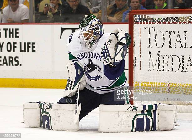 Eddie Lack of the Vancouver Canucks makes a save in the first period against the Pittsburgh Penguins during the game at Consol Energy Center on...