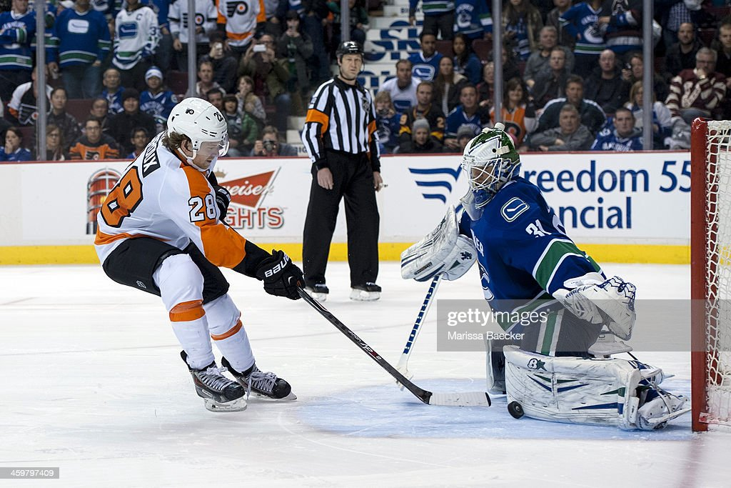 Eddie Lack #31 of the Vancouver Canucks makes a save on a shot from <a gi-track='captionPersonalityLinkClicked' href=/galleries/search?phrase=Claude+Giroux&family=editorial&specificpeople=537961 ng-click='$event.stopPropagation()'>Claude Giroux</a> #28 of the Philadelphia Flyers during the shoot out on December 30, 2013 at Rogers Arena in Vancouver, British Columbia, Canada.