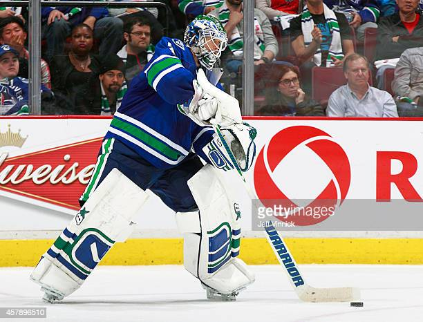 Eddie Lack of the Vancouver Canucks plays the puck during their NHL game against theTampa Bay Lightning at Rogers Arena October 18 2014 in Vancouver...