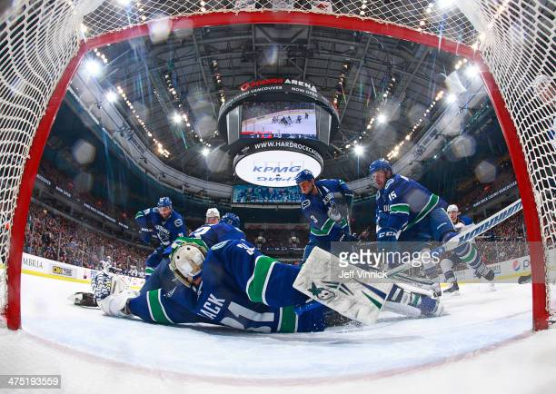 Eddie Lack of the Vancouver Canucks sprawls to make a save against the St Louis Blues during their NHL game at Rogers Arena February 26 2014 in...