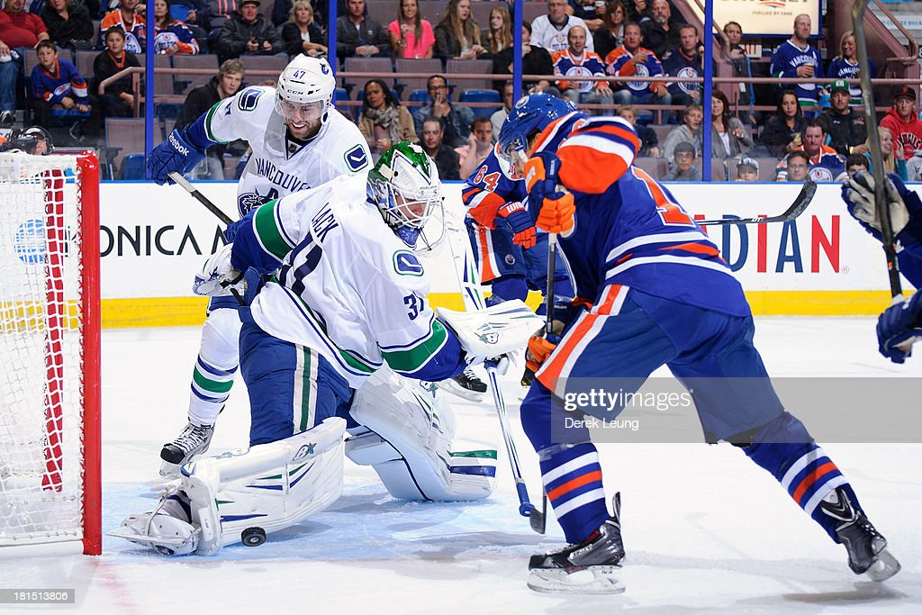Eddie Lack #31 of the Vancouver Canucks stopes the shot of <a gi-track='captionPersonalityLinkClicked' href=/galleries/search?phrase=Jordan+Eberle&family=editorial&specificpeople=4898161 ng-click='$event.stopPropagation()'>Jordan Eberle</a> #14 of the Edmonton Oilers during a preseason NHL game at Rexall Place on September 21, 2013 in Edmonton, Alberta, Canada.