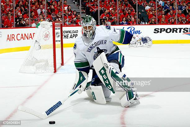 Eddie Lack the Vancouver Canucks skates out of the crease to handle the puck against the Calgary Flames at Scotiabank Saddledome for Game Three of...