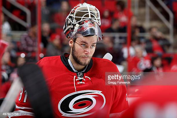 Eddie Lack#31 of the Carolina Hurricanes skates to the bench area during a time out of a NHL game against the Anaheim Ducks at PNC Arena on November...