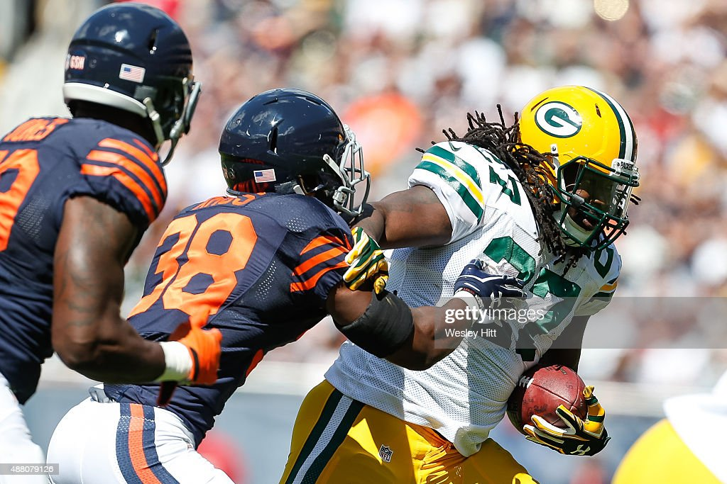 <a gi-track='captionPersonalityLinkClicked' href=/galleries/search?phrase=Eddie+Lacy&family=editorial&specificpeople=6902550 ng-click='$event.stopPropagation()'>Eddie Lacy</a> #27 of the Green Bay Packers carries the football past <a gi-track='captionPersonalityLinkClicked' href=/galleries/search?phrase=Adrian+Amos&family=editorial&specificpeople=8489598 ng-click='$event.stopPropagation()'>Adrian Amos</a> #38 of the Chicago Bears in the second half at Soldier Field on September 13, 2015 in Chicago, Illinois.