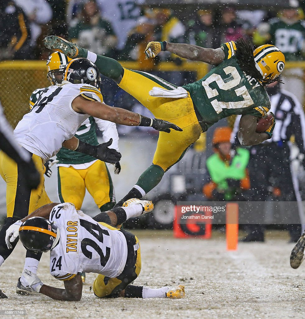 <a gi-track='captionPersonalityLinkClicked' href=/galleries/search?phrase=Eddie+Lacy&family=editorial&specificpeople=6902550 ng-click='$event.stopPropagation()'>Eddie Lacy</a> #27 of the Green Bay Packers dives into the end zone for a touchdown over Chris Carter #54 and <a gi-track='captionPersonalityLinkClicked' href=/galleries/search?phrase=Ike+Taylor&family=editorial&specificpeople=748703 ng-click='$event.stopPropagation()'>Ike Taylor</a> #24 of the Pittsburgh Steelers at Lambeau Field on December 22, 2013 in Green Bay, Wisconsin.