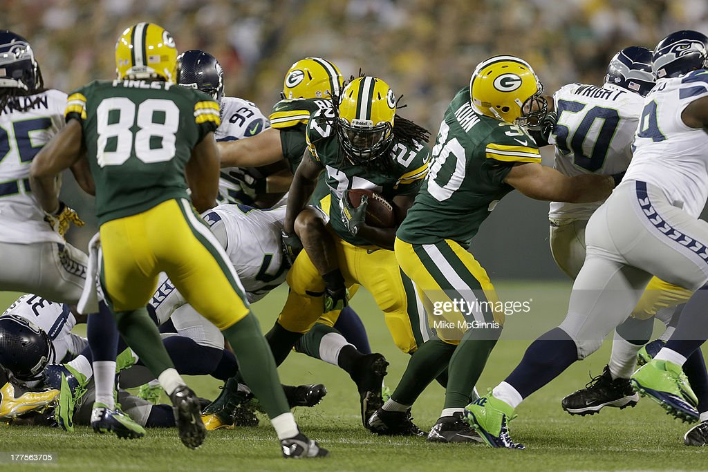 <a gi-track='captionPersonalityLinkClicked' href=/galleries/search?phrase=Eddie+Lacy&family=editorial&specificpeople=6902550 ng-click='$event.stopPropagation()'>Eddie Lacy</a> #27 of the Green Bay Packers finds the hole in the Seattle Seahawks defense during the game at Lambeau Field on August 23, 2013 in Green Bay, Wisconsin.