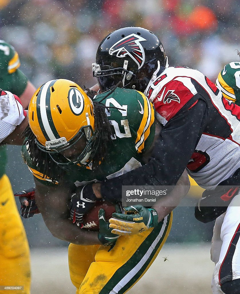 <a gi-track='captionPersonalityLinkClicked' href=/galleries/search?phrase=Eddie+Lacy&family=editorial&specificpeople=6902550 ng-click='$event.stopPropagation()'>Eddie Lacy</a> #27 of the Green Bay Packers is tackled by WilliamMoore #25 of the Atlanta Falcons at Lambeau Field on December 8, 2013 in Green Bay, Wisconsin. The Packers defeated the Falcons 22-21.