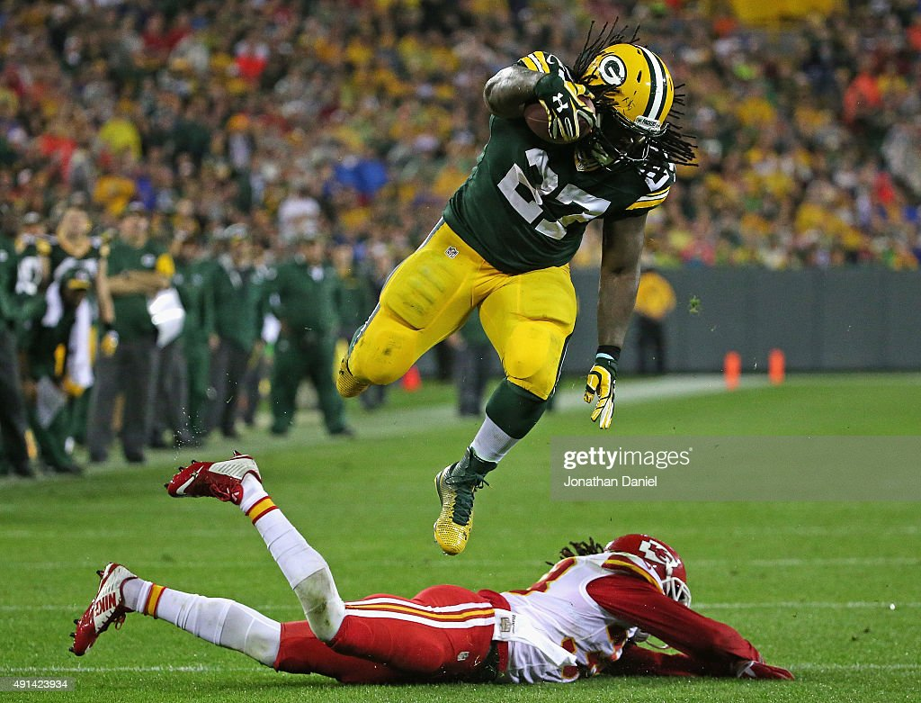 <a gi-track='captionPersonalityLinkClicked' href=/galleries/search?phrase=Eddie+Lacy&family=editorial&specificpeople=6902550 ng-click='$event.stopPropagation()'>Eddie Lacy</a> #27 of the Green Bay Packers leaps over <a gi-track='captionPersonalityLinkClicked' href=/galleries/search?phrase=Ron+Parker+-+American+Football+Player&family=editorial&specificpeople=13548013 ng-click='$event.stopPropagation()'>Ron Parker</a> #38 of the Kansas City Chiefs to run for a first down at Lambeau Field on September 28, 2015 in Green Bay, Wisconsin. The Packers defeated the Chiefs 38-28.