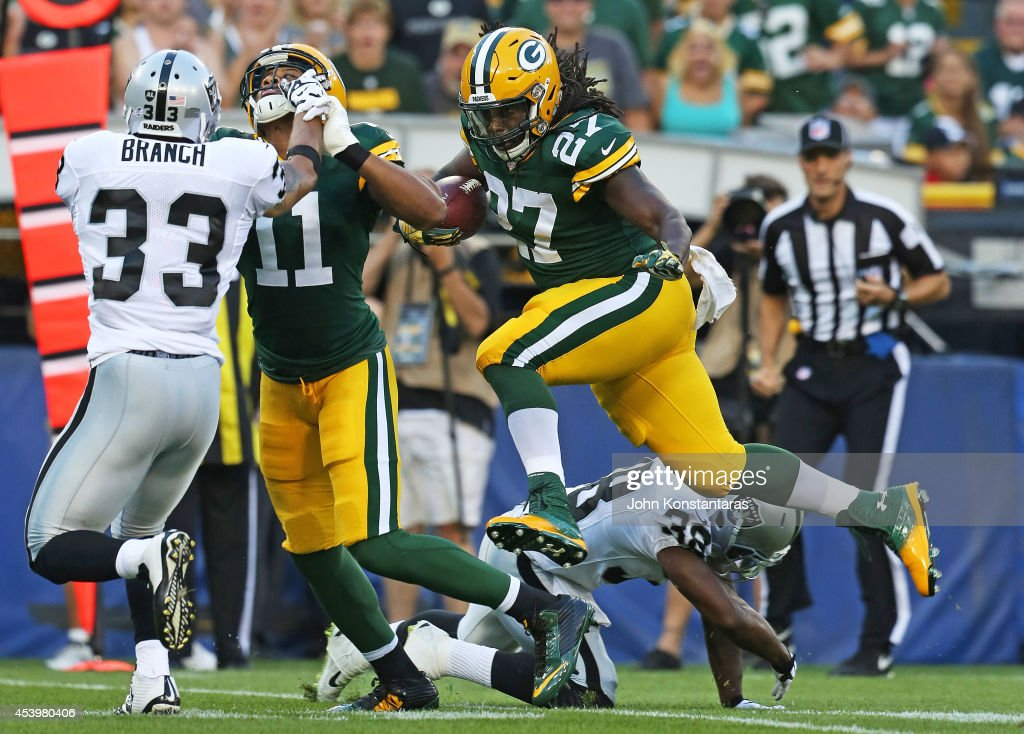 <a gi-track='captionPersonalityLinkClicked' href=/galleries/search?phrase=Eddie+Lacy&family=editorial&specificpeople=6902550 ng-click='$event.stopPropagation()'>Eddie Lacy</a> #27 of the Green Bay Packers runs for a first down during the first quarter of their preseason game against Oakland Raiders at Lambeau Field on August 22, 2014 in Green Bay, Wisconsin.