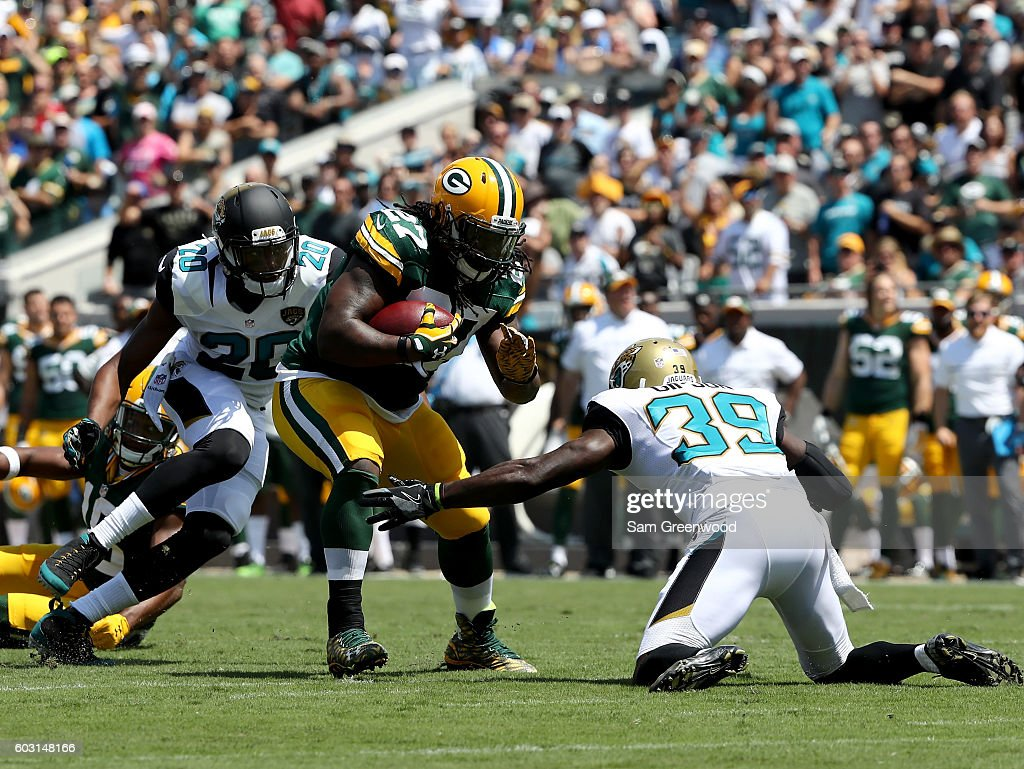 Eddie Lacy #27 of the Green Bay Packers rushes past Tashaun Gipson #39 of the Jacksonville Jaguars at EverBank Field on September 11, 2016 in Jacksonville, Florida.