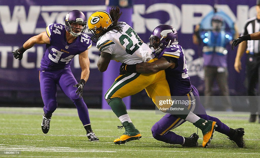 <a gi-track='captionPersonalityLinkClicked' href=/galleries/search?phrase=Eddie+Lacy&family=editorial&specificpeople=6902550 ng-click='$event.stopPropagation()'>Eddie Lacy</a> #27 of the Green Bay Packers tries to break free from <a gi-track='captionPersonalityLinkClicked' href=/galleries/search?phrase=Erin+Henderson&family=editorial&specificpeople=4142874 ng-click='$event.stopPropagation()'>Erin Henderson</a> #50 of the Minnesota Vikings on October 27, 2013 at Mall of America Field at the Hubert Humphrey Metrodome in Minneapolis, Minnesota.