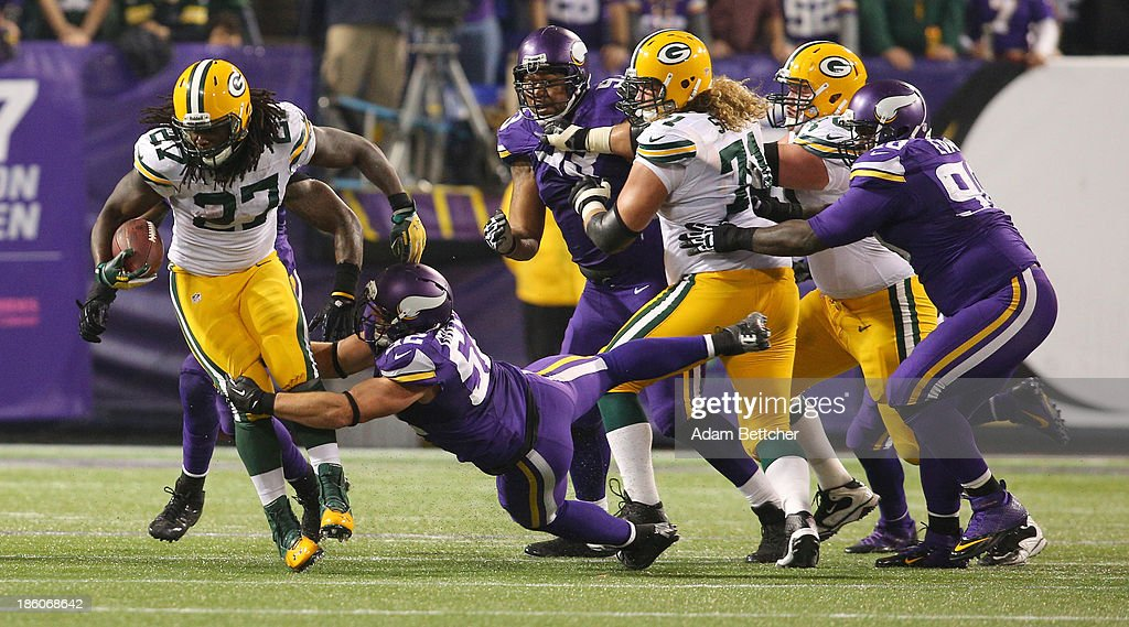 <a gi-track='captionPersonalityLinkClicked' href=/galleries/search?phrase=Eddie+Lacy&family=editorial&specificpeople=6902550 ng-click='$event.stopPropagation()'>Eddie Lacy</a> #27 of the Green Bay Packers tries to break the tackle from <a gi-track='captionPersonalityLinkClicked' href=/galleries/search?phrase=Chad+Greenway&family=editorial&specificpeople=749155 ng-click='$event.stopPropagation()'>Chad Greenway</a> #52 of the Minnesota Vikings on October 27, 2013 at Mall of America Field at the Hubert Humphrey Metrodome in Minneapolis, Minnesota.