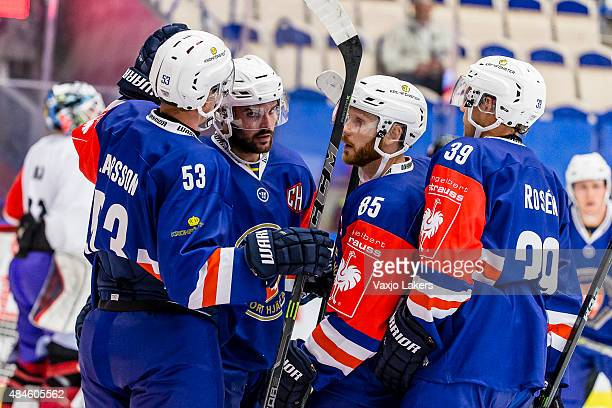 Eddie Larsson Linus Froberg Liam Reddox and Calle Rosen celebrates after goal 71 during the Champions Hockey League group stage game between Vaxjo...