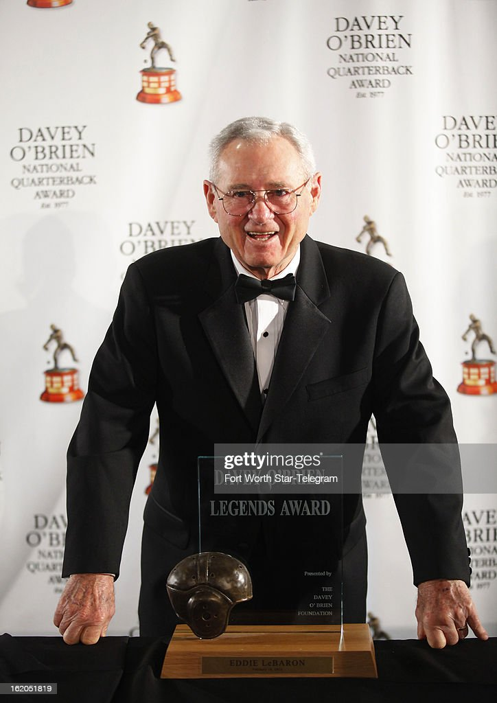 Eddie LeBaron, the first quarterback for the Dallas Cowboys, poses with the Davey O'Brien Legends Award during the Davey O'Brien Awards press conference at the Fort Worth Club in Fort Worth, Texas, Monday, February 18, 2013.