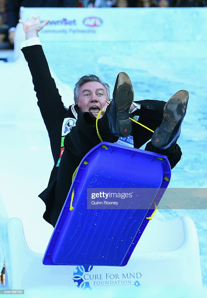 Eddie McGuire goes down the slide for Freeze MND during the round 12 AFL match between the Melbourne Demons and the Collingwood Magpies at Melbourne...