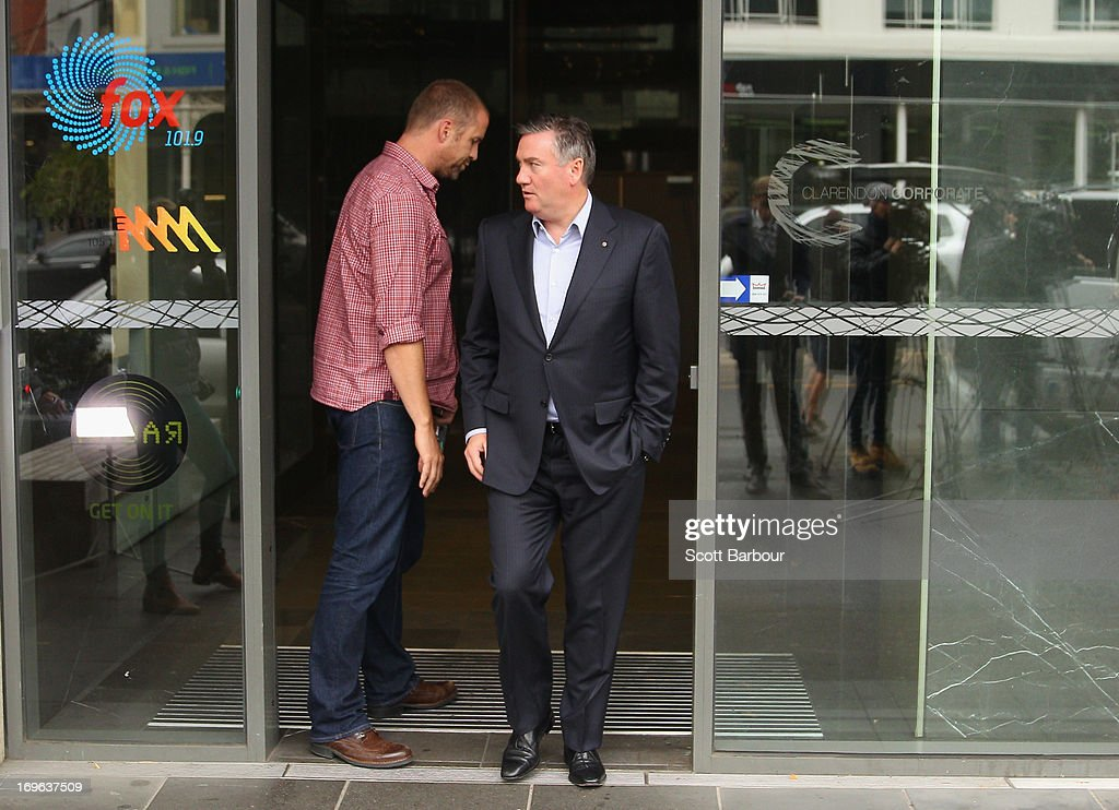 Eddie McGuire walks past Jay Mueller Executive Producer of the Hot Breakfast Triple M as he arrives to speak to the media outside of the offices of...