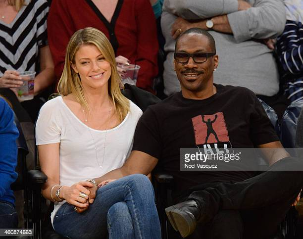 Eddie Murphy and Paige Butcher attend a basketball game between the Denver Nuggets and the Los Angeles Lakers at Staples Center on January 5 2014 in...