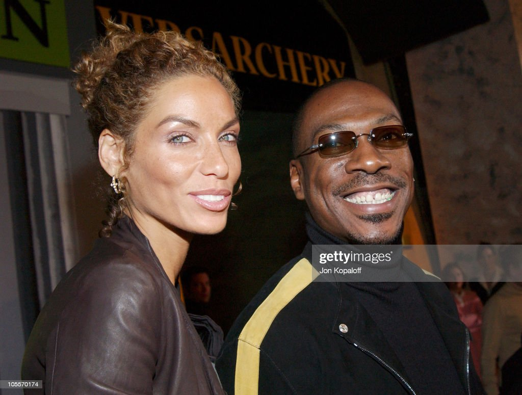 Eddie Murphy and wife Nicole Mitchell during DreamWorks Celebrates The DVD Release of 'Shrek 2' at Spago in Beverly Hills California United States