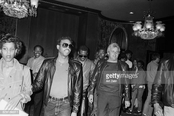 Eddie Murphy center wearing a leather jacket circa 1970 New York