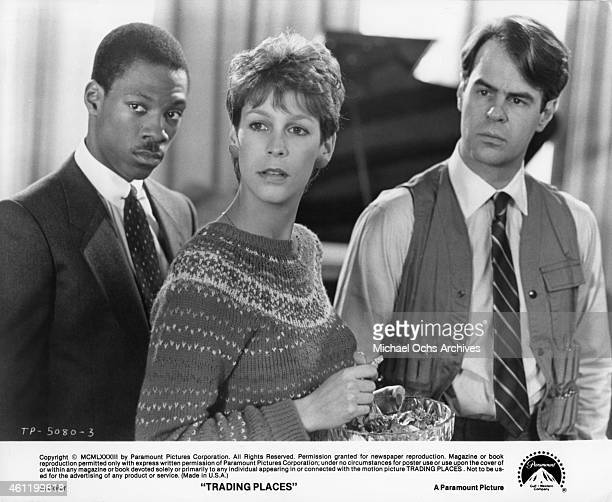 Eddie Murphy Jamie Lee Curtis and Dan Aykroyd in a scene from the Paramount Pictures movie 'Trading Places' in 1983 in New York City New York
