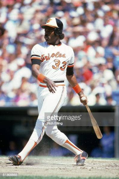 Eddie Murray of the Baltimore Orioles watches the flight of the ball as he follows through on a swing during a game circa 19771988