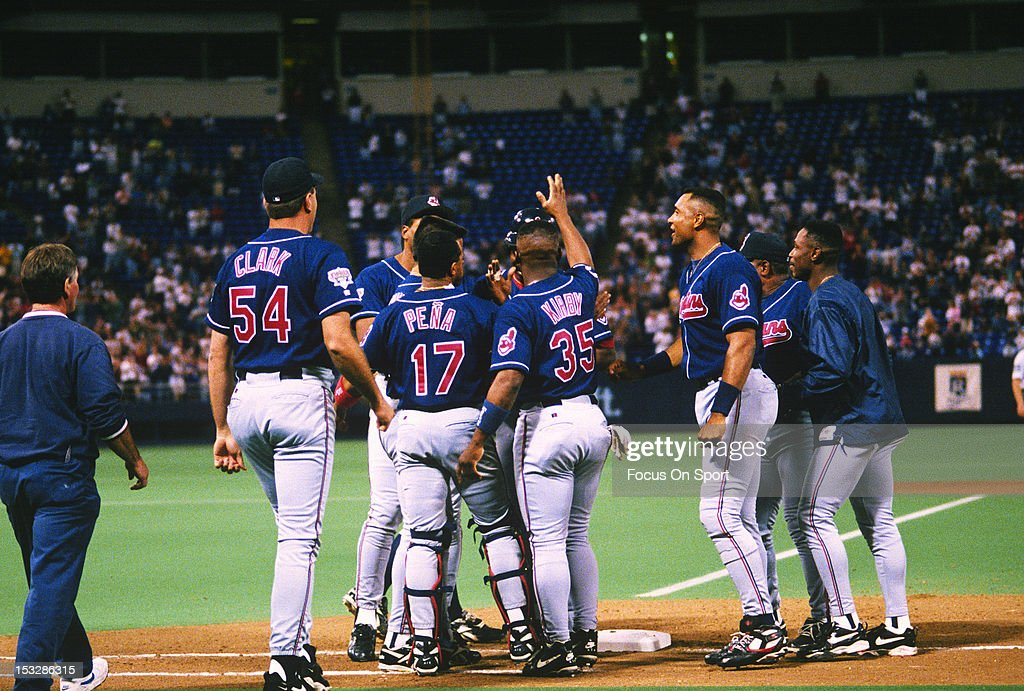 <a gi-track='captionPersonalityLinkClicked' href=/galleries/search?phrase=Eddie+Murray&family=editorial&specificpeople=210573 ng-click='$event.stopPropagation()'>Eddie Murray</a> #33 of the Cleveland Indians is congratulated by teammates after Murray gets his 3000th career hit against the Minnesota Twins during an Major League baseball game June 30, 1995 at the Hubert Humphrey Metrodome in Minneapolis, Minnesota. Murray played for the Indians from 1994-96.