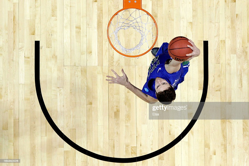 <a gi-track='captionPersonalityLinkClicked' href=/galleries/search?phrase=Eddie+Murray&family=editorial&specificpeople=210573 ng-click='$event.stopPropagation()'>Eddie Murray</a> #23 of the Florida Gulf Coast Eagles dunks against the Georgetown Hoyas during the second round of the 2013 NCAA Men's Basketball Tournament at Wells Fargo Center on March 22, 2013 in Philadelphia, Pennsylvania.
