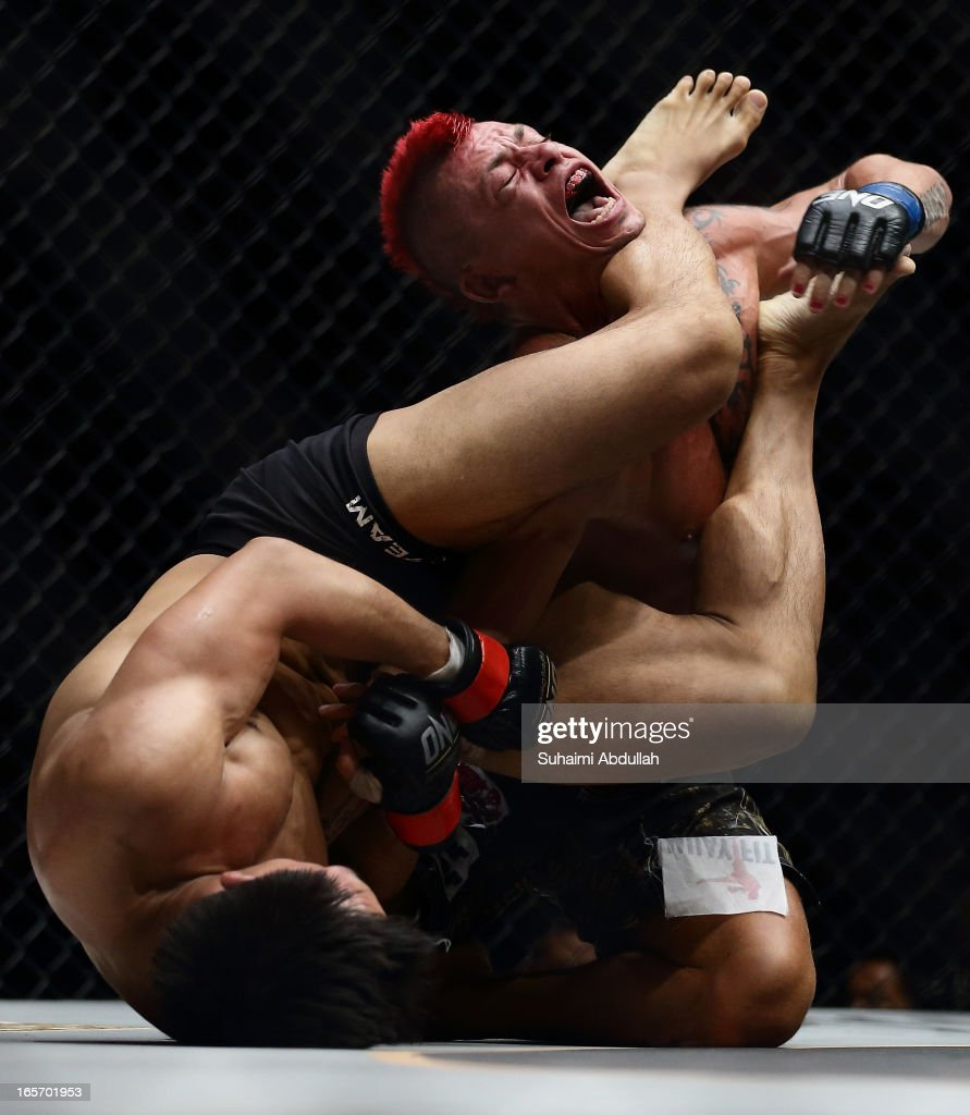 Eddie Ng of Hong Kong (L) locks Arnaud Lepont of France for a submission win during the One Fighting Championship at Singapore Indoor Stadium on April 5, 2013 in Singapore.
