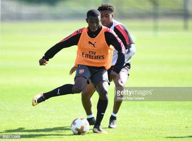 Eddie Nketiah and Alex Iwobi of Arsenal during a training session at London Colney on September 13 2017 in St Albans England