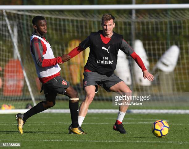 Eddie Nketiah and Rob Holding of Arsenal during a training session at London Colney on November 17 2017 in St Albans England
