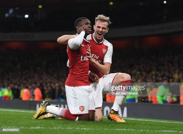 Eddie Nketiah celebrates scoring the 2nd Arsenal goal with Rob Holding during the Carabao Cup Fourth Round match between Arsenal and Norwich City at...