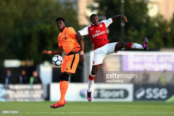 Eddie Nketiah of Arsenal and Ovie Ejaria of Liverpool in action during the Premier League 2 match between Arsenal and Liverpool at Meadow Park on...