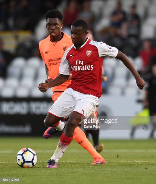 Eddie Nketiah of Arsenal is challenged by Ovie Ejaria of Liverpool during the match between Arsenal and Liverpool at Meadow Park on August 25 2017 in...