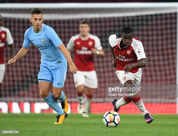 Eddie Nketiah of Arsenal takes on Charlie Olivier of Man City during the Premier League 2 match between Arsenal and Manchester City at Emirates...
