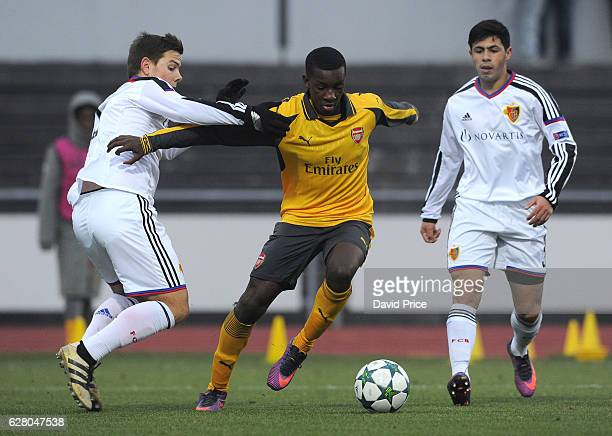 Eddie Nketiah of Arsenal takes on Yves Kaiser of Basel during the UEFA Champions League match between FC Basel and Arsenal at Leichtathletik Stadion...