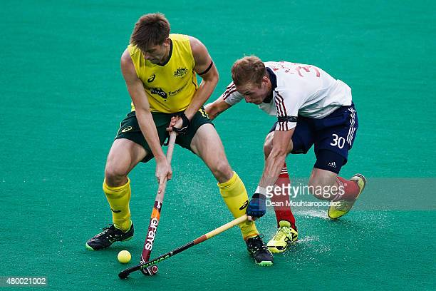 Eddie Ockenden of Australia battles for the ball with David Ames of Great Britain during the Fintro Hockey World League SemiFinal match between...