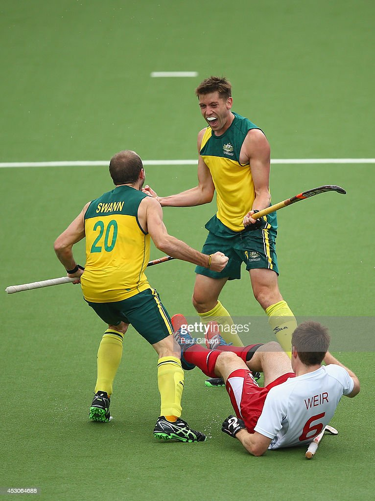 <a gi-track='captionPersonalityLinkClicked' href=/galleries/search?phrase=Eddie+Ockenden&family=editorial&specificpeople=4132629 ng-click='$event.stopPropagation()'>Eddie Ockenden</a> of Australia celebrates with Matthew Swann after scoring the fourth goal for Australia as <a gi-track='captionPersonalityLinkClicked' href=/galleries/search?phrase=Henry+Weir&family=editorial&specificpeople=10009175 ng-click='$event.stopPropagation()'>Henry Weir</a> of England looks on in the Men's Semi-Final match between Australia and England at Glasgow National Hockey Centre during day ten of the Glasgow 2014 Commonwealth Games on August 2, 2014 in Glasgow, United Kingdom.