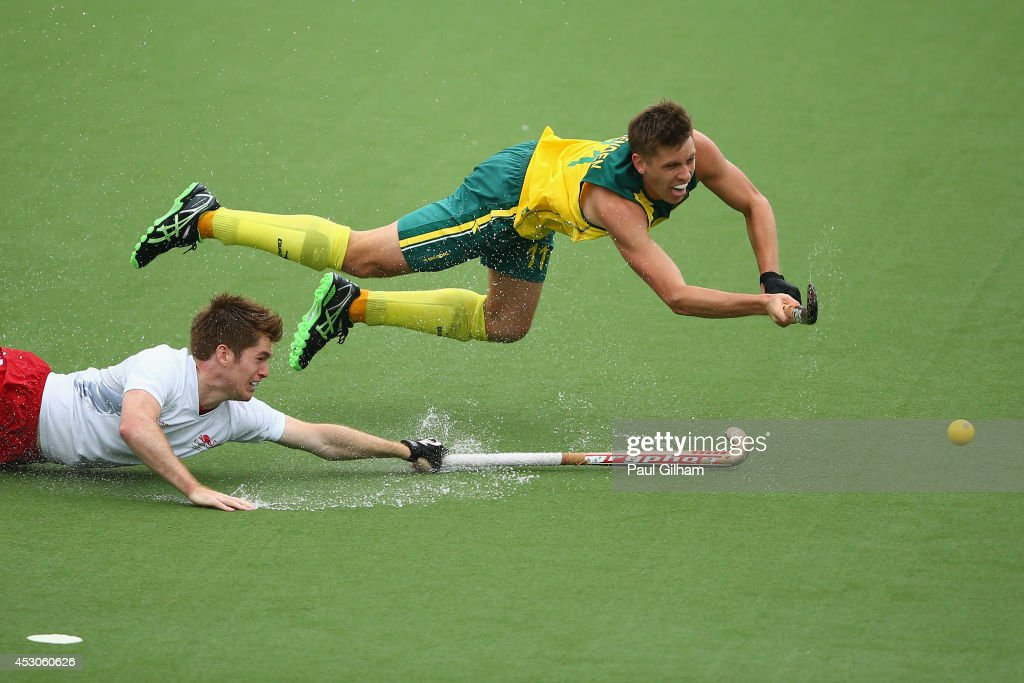 <a gi-track='captionPersonalityLinkClicked' href=/galleries/search?phrase=Eddie+Ockenden&family=editorial&specificpeople=4132629 ng-click='$event.stopPropagation()'>Eddie Ockenden</a> of Australia scores the fourth goal for Australia as <a gi-track='captionPersonalityLinkClicked' href=/galleries/search?phrase=Henry+Weir&family=editorial&specificpeople=10009175 ng-click='$event.stopPropagation()'>Henry Weir</a> of England looks on in the Men's Semi-Final match between Australia and England at Glasgow National Hockey Centre during day ten of the Glasgow 2014 Commonwealth Games on August 2, 2014 in Glasgow, United Kingdom.